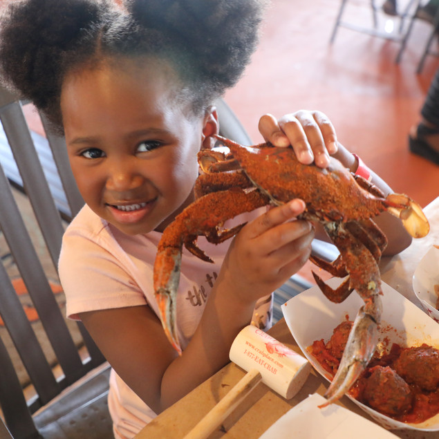 Little girl holding Crab Place jimmy crab
