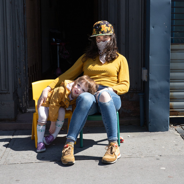 Jessica, a single mom with MS, and her toddler, Mila, create their own stoop with 2 chairs in Carroll Gardens