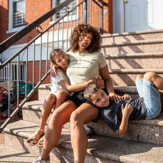 Eve, a single mom, activist and COVID survivor, with her kids, Tava and Quino in Gowanus