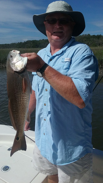 His first keeper redfish