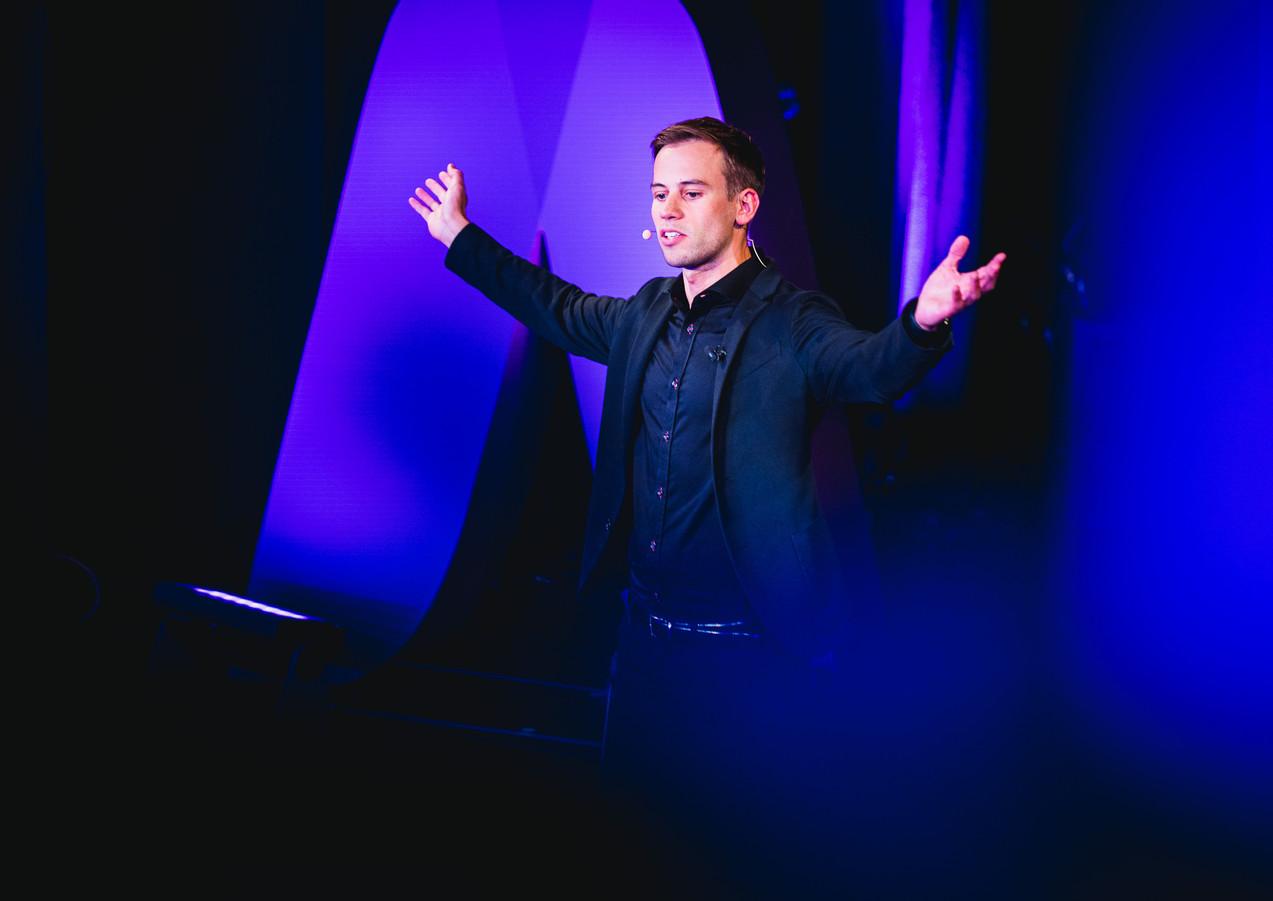 Christoph Burkhardt - stage arms up.jpg