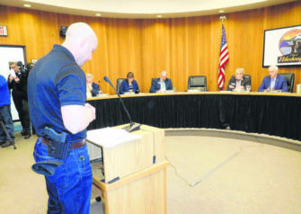 "Eric Hargrave, owner of the Washougal-based retail firearms business, Limitless America, speaks in favor of a resolution that asks Washougal city councilors to declare the city a ""Second Amendment sanctuary city,"" to protect people's right to keep and bear arms, while also making a statement that no sheriff, police chief, agent, employee or official of their respective jurisdictions enforce any act, order, rule, law or regulation 'repugnant' to the right to keep and bear arms. (Post-Record file photo)"