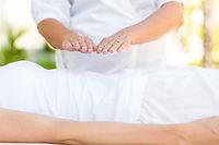Calm woman receiving reiki treatment in the health spa.jpg