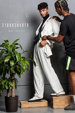 Fashion stylist dressing model
