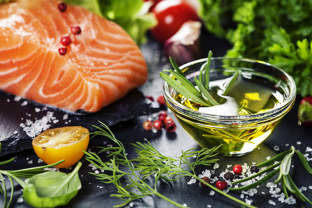 Delicious  portion of fresh salmon fillet  with aromatic herbs, spices and vegetables - healthy food.jpg