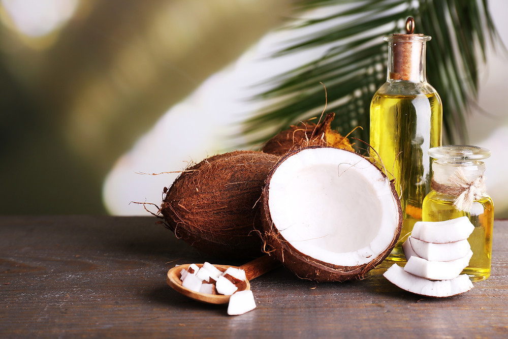 Coconuts and coconut oil on wooden table.jpg