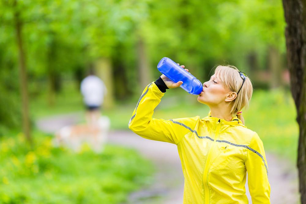Female Runner Drinking Water.jpg