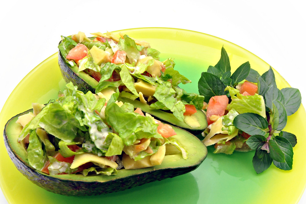 Stuffed avocados in a plate.jpg