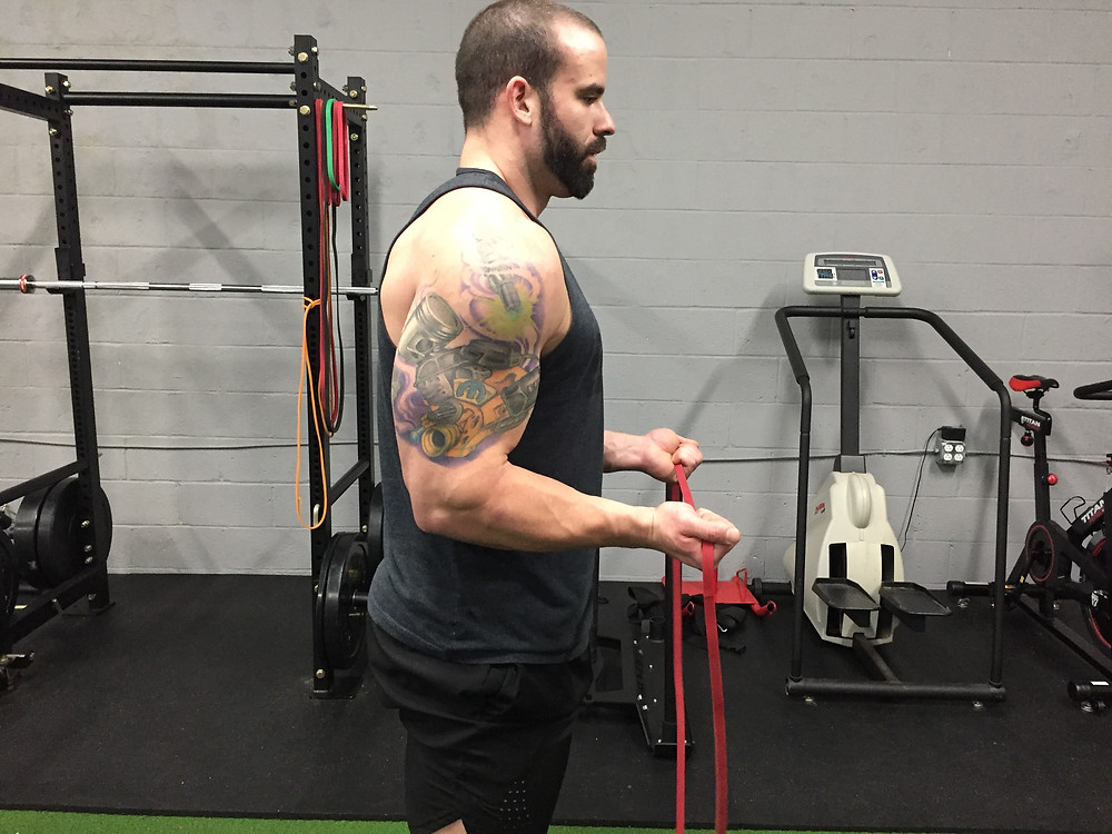 Shoulders rolled forward with upper back rounded.