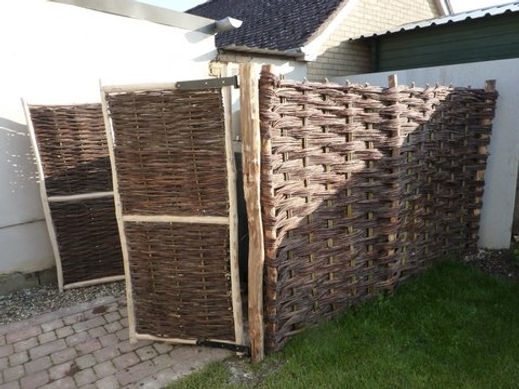 Oil tank willow screen, willow work, willow fencing, ash gates, woven worlds, gates, traditional green craft,  oil drum cover ideas
