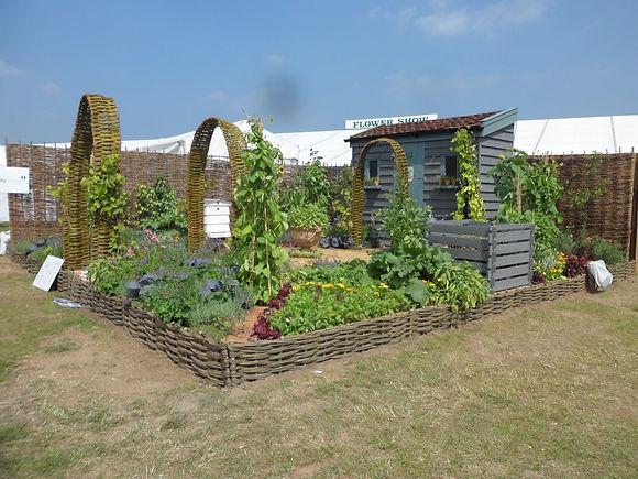 organic garden, raised beds, veg beds, willow rasied beds, allotment garden ideas, otley college garden design