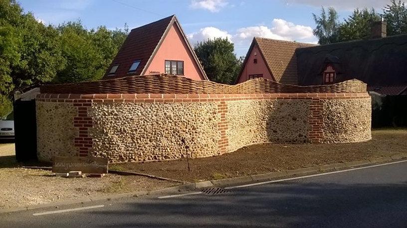 Flint wall curved, quality flint wall suffolk, suffolk flint, flint graham north, flint walls wovenworlds, serpentine flint wall, flint man suffolk