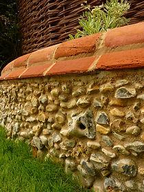 flint wall service woven worlds, flint repair, fl;int images, garden ideas, flint repair work, flint wall repair, woven worlds