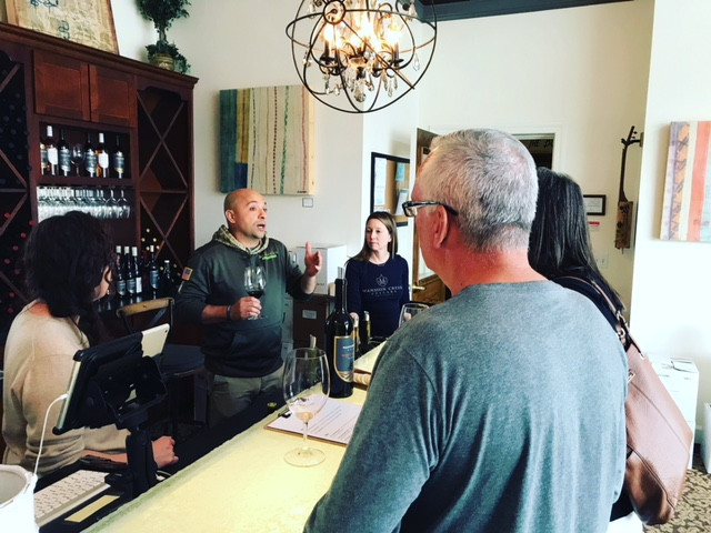 Denny Russell sharing his family's history & heritage with customers in the tasting room.