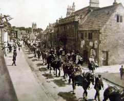 Old photograph of horses being led down Marshfiedl High Street