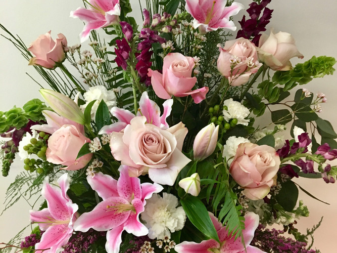 Roses and Lillies in pink.