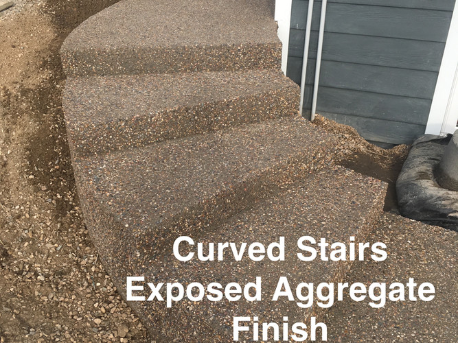 Curved stairs with aggregate finish