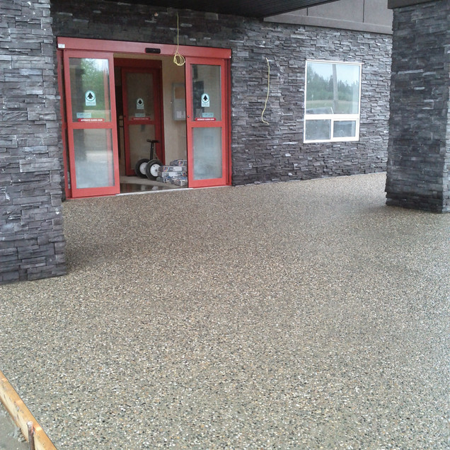 Exposed aggregate under hotel covered main entrance