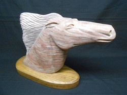 Carved stone horse head