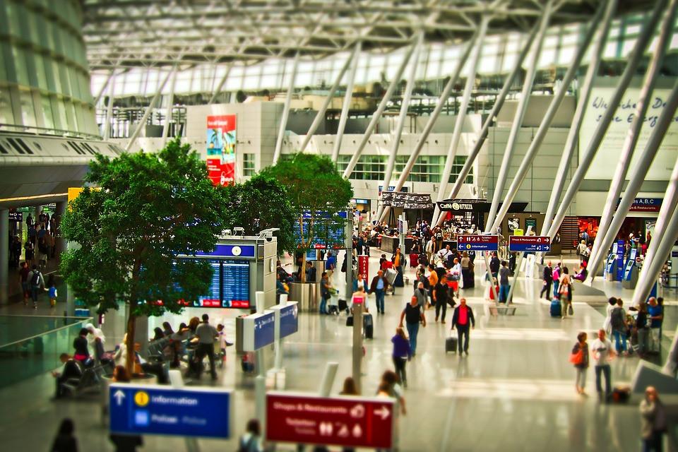 travelers at an international airport