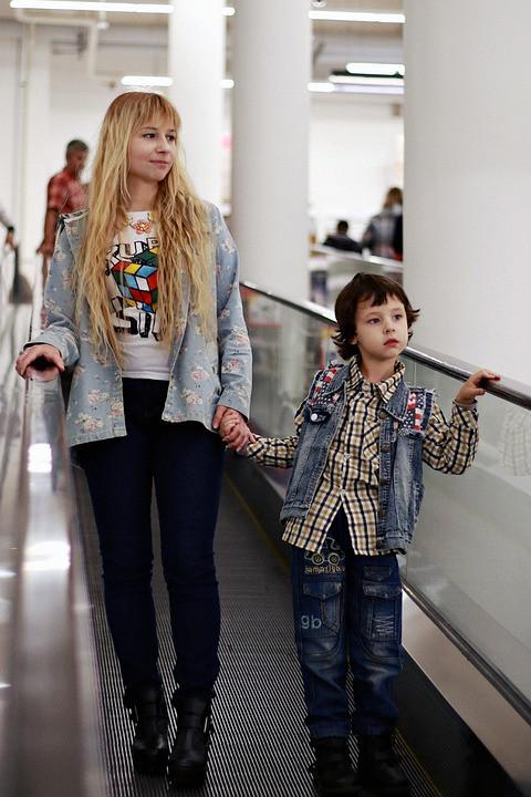 Kid and mom at airport