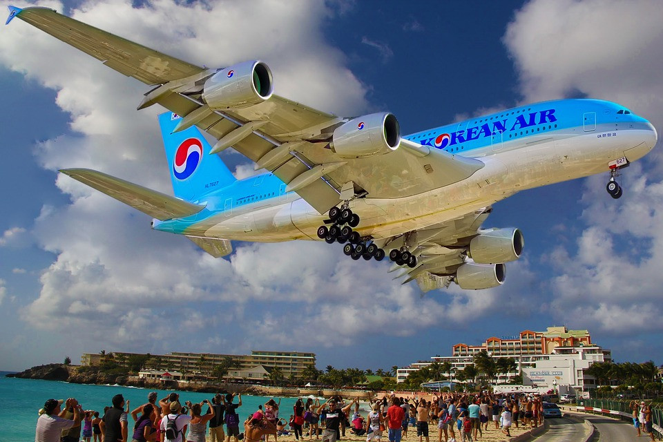 kool close up of landing airplane by a beach