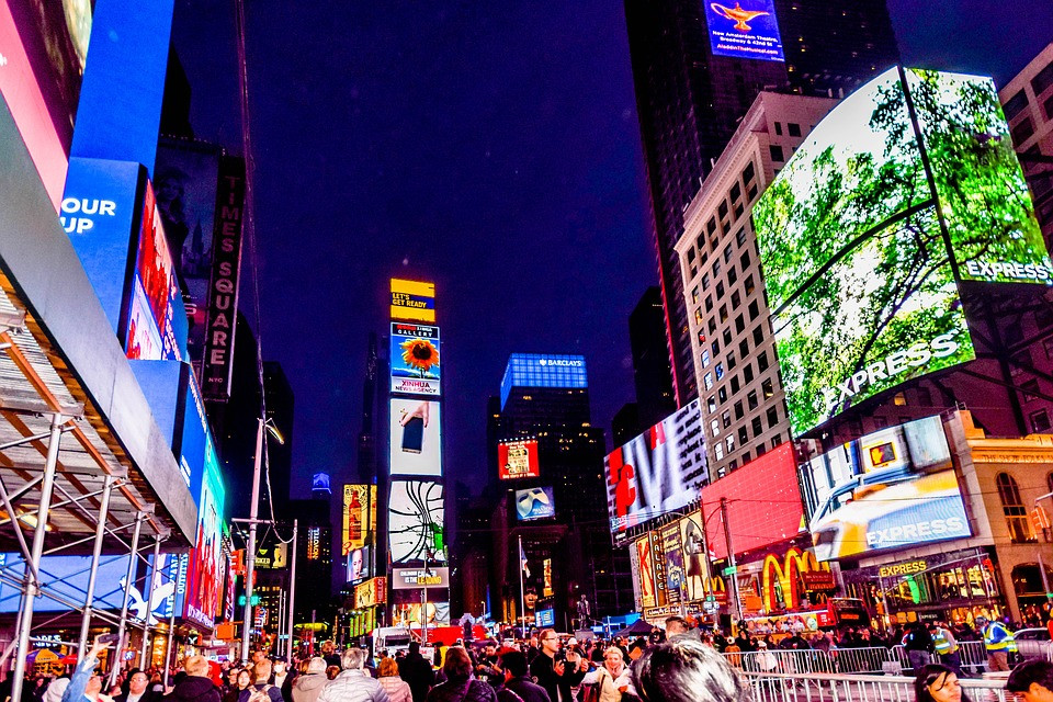 Time square New York, with the LED screens and visitors enjoying the scene