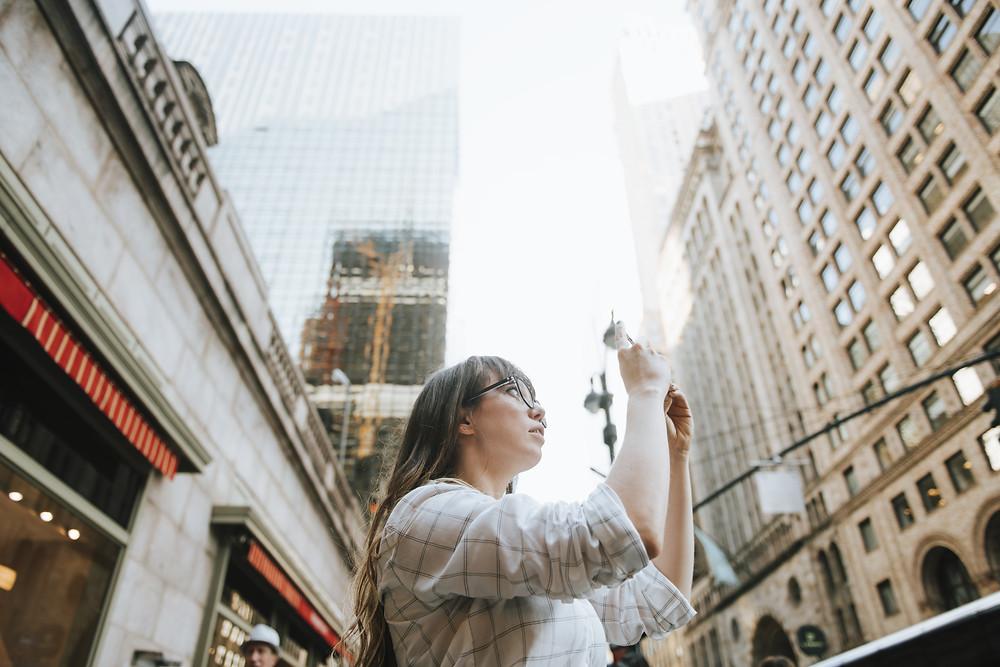 Girl enjoying new york, and taking photos of the differet new york landmarks