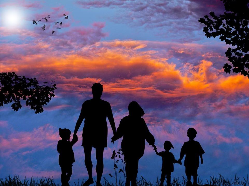 family enjoying a sunset