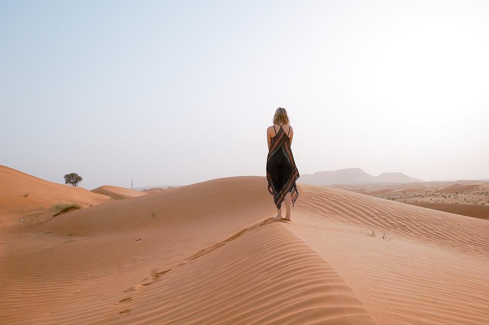 walking on the dunes in the desert
