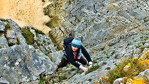 Rhian Climbing on Gower
