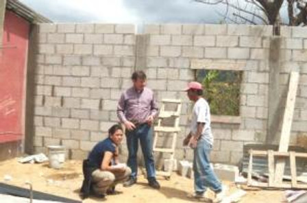 Greg meets on-site to layout drains, counters and electric for the new kitchen. Rocio, project coordinator is the young lady.