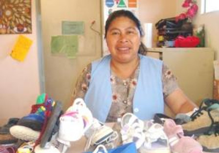 Rosario hands out shoes to the most needy.