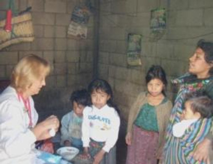 Anita giving medicine to Marta