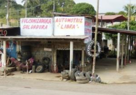 Common type of roadside tire repair, some advertise auto repair, too.
