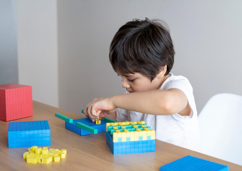 Child using dienes blocks for maths