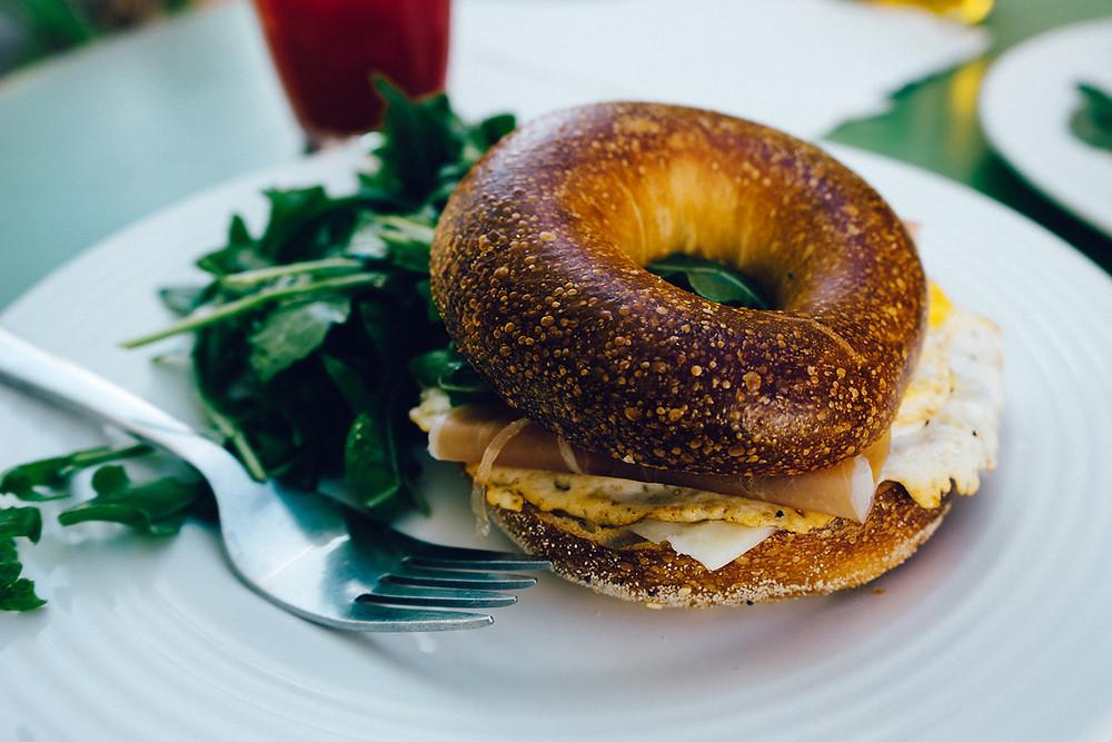 a plate with a bagel breakfast sandwich