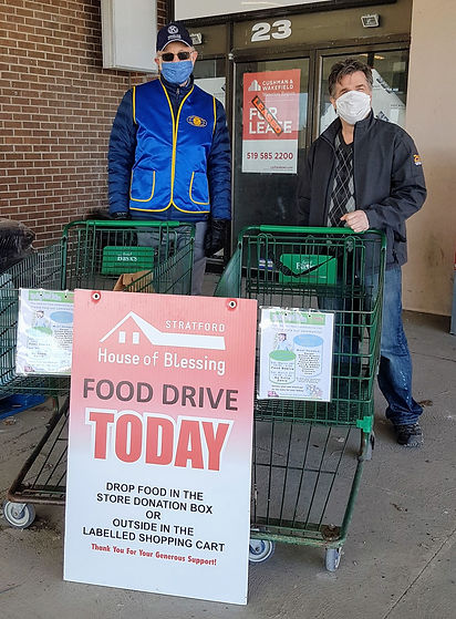 Photo showing Kiwanis volunteer  and Jamie Cottle from CJCS at our food drive