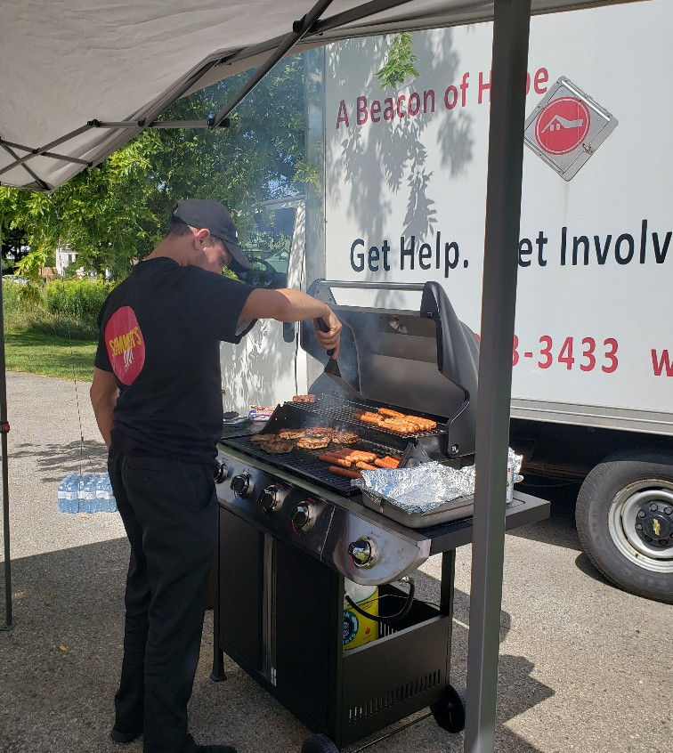 Sobeys manager, Jason Hart, came to help cook burgers and hot dogs at our BBQ — at Stratford House of Blessing.