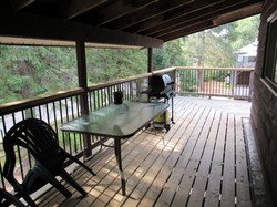 Chalet has a covered deck