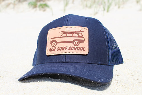 Navy Blue trucker hat with leather patch