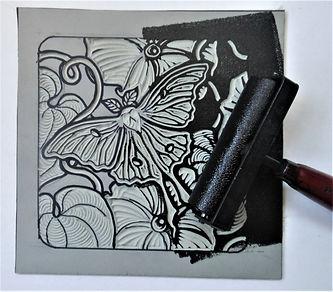 Rolling ink on Moth print.jpg
