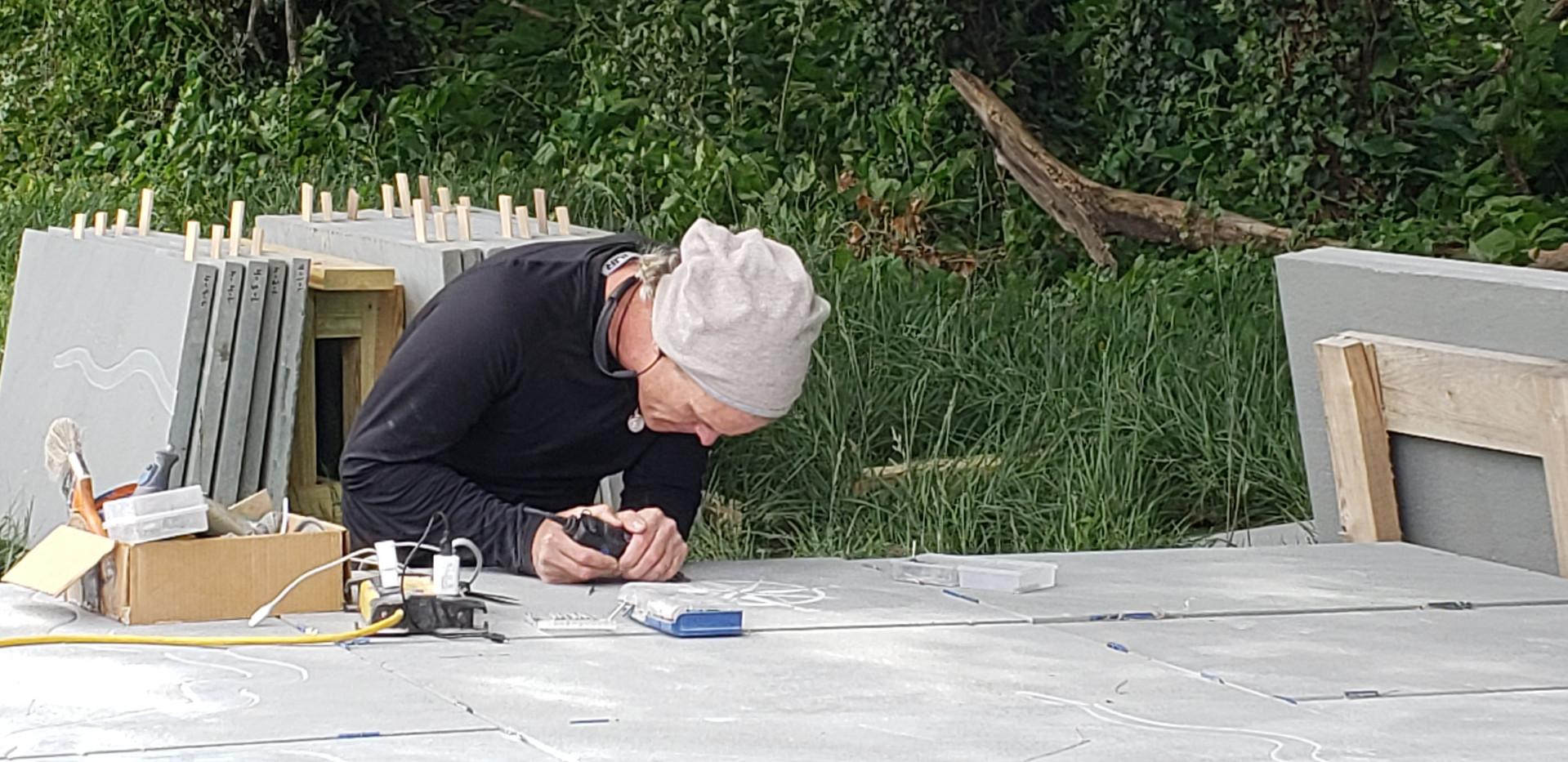 Eddie head down working on sculpture