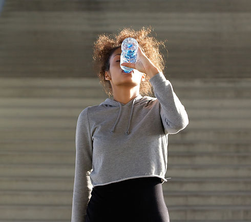 thirsty-young-woman-drinking-from-water-