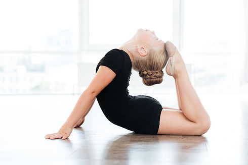 Little girl dancer stretching with arched back
