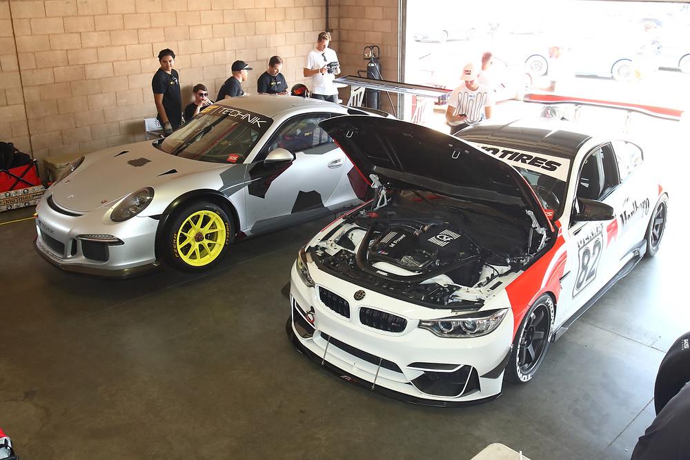 Porsche 991 GT3 Cup, BMW F82 M4, and Audi R8 at GT Technik's garage area