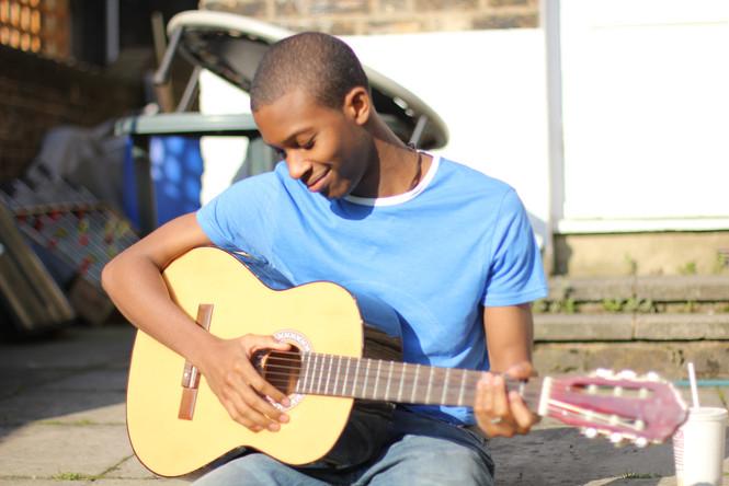 Julz playing guitar