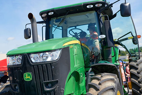 Green Tractor with Family