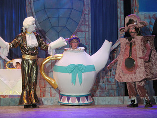 Wesley Thomas as Lumiere, Peggy Pulvirenti as Mrs Potts and Bernie Lanigan as Cogsworth