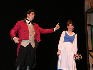 Brendan Kavanagh as Gaston and Candice Nugent as Belle